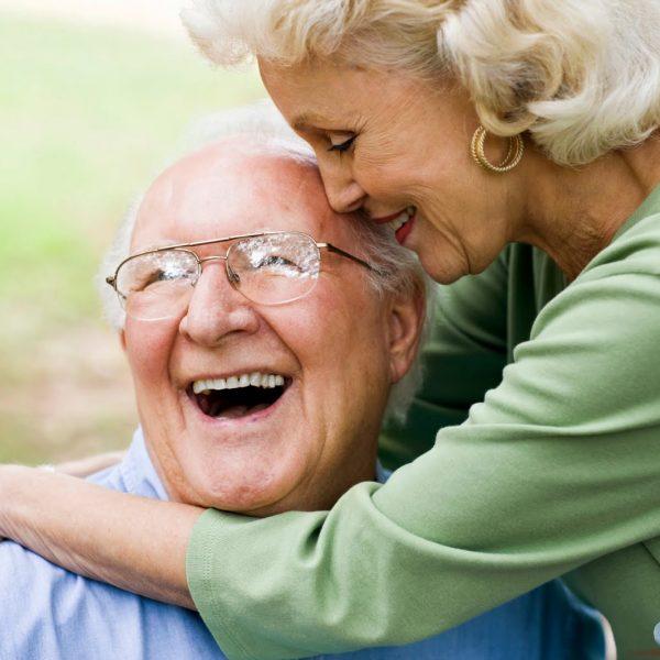 Happy Ederly couple embrace